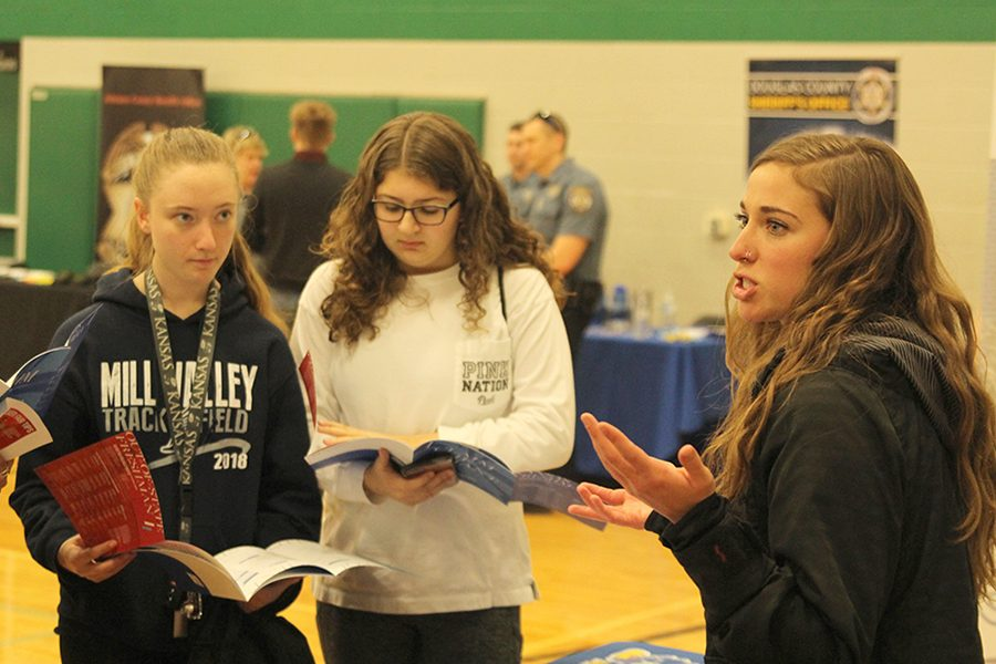 University+of+Kansas+admissions+officer+Emily+Hoffman+explains+the+enrollment+process+to+a+group+of+Mill+Valley+students.+%22I+look+at+all+the+schools+that+are+coming+%5Bto+the+career+fair%5D+and+get+a+judgement+of+how+many+students+are+going+to+attend+%5BUniversity+of+Kansas%5D%2C%22+Hoffman+said.