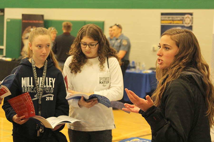 University of Kansas admissions officer Emily Hoffman explains the enrollment process to a group of Mill Valley students.