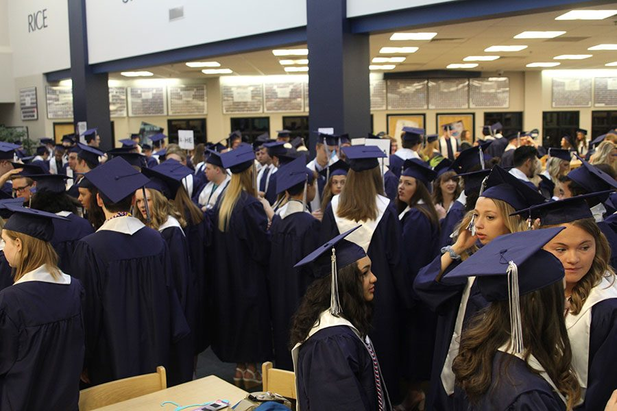 Seniors+gather+in+the+media+center+prior+to+starting+the+graduation+ceremony.