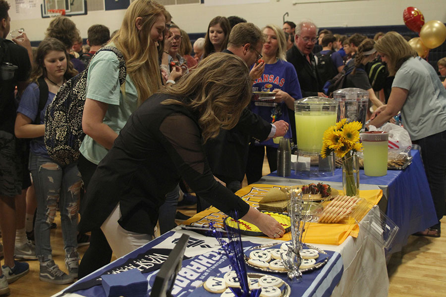 After+the+ceremony%2C+parents+and+friends+celebrate+the+athletes+who+signed+to+play+at+the+collegiate+level.