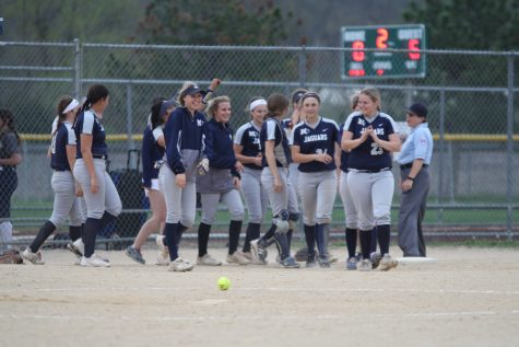 After winning two of their games against Saint James Academy Tuesday, May 1st, the softball team smiles as they walk on the field.