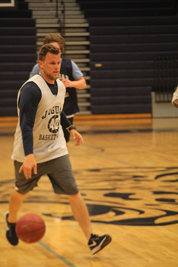 Dribbling down the court, paraprofessional Zach McFall plays at the annual student faculty basketball game on Tuesday, May 8.