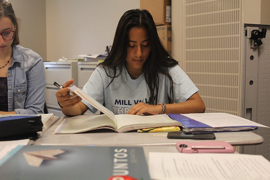 Using her textbook during a test, junior Zurieli Rojas is an example of what students selected to take the STAMP biliteracy exam looked like on Tuesday, Apr. 20.