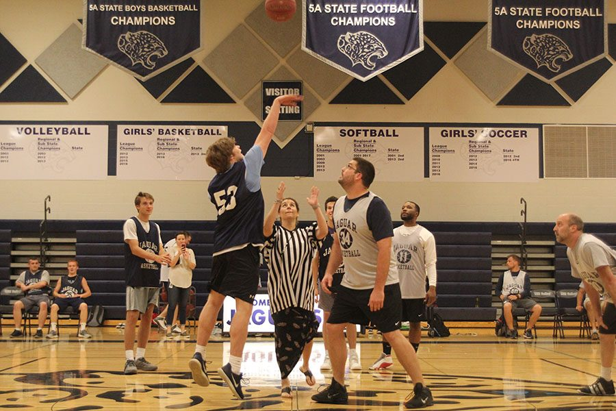 Jumping for the tip off, senior Cooper Kaifes attains possession of the ball at the beginning of the scrimmage.