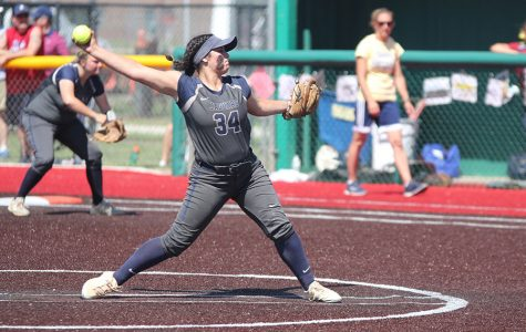 Sophomore pitcher Jessica Garcia winds up to pitch the ball on Friday, May 25. The team lost to Topeka Seaman, 8-6, placing fourth in the state tournament.