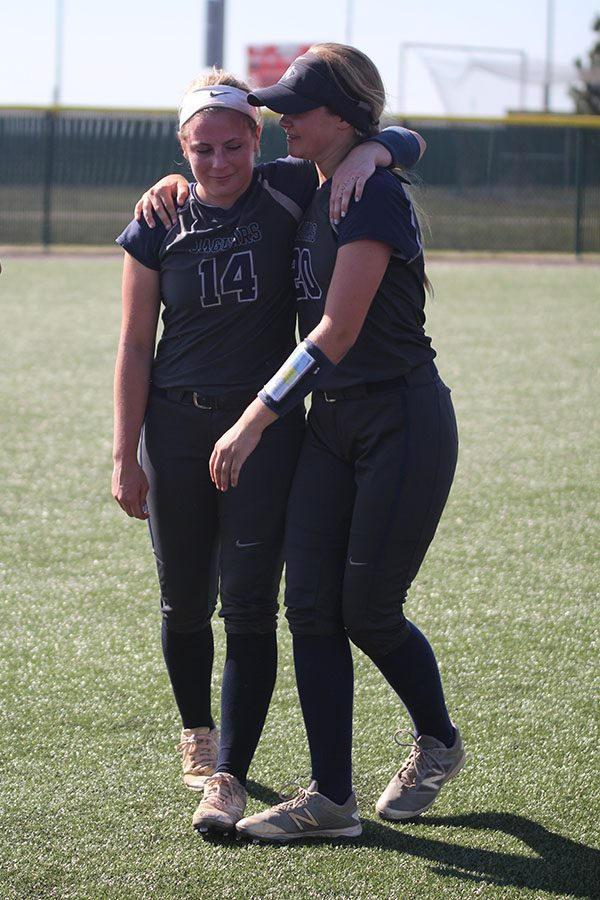 - At the conclusion of the game and awards ceremony, senior Peyton Moeder and junior Haley Puccio embrace.