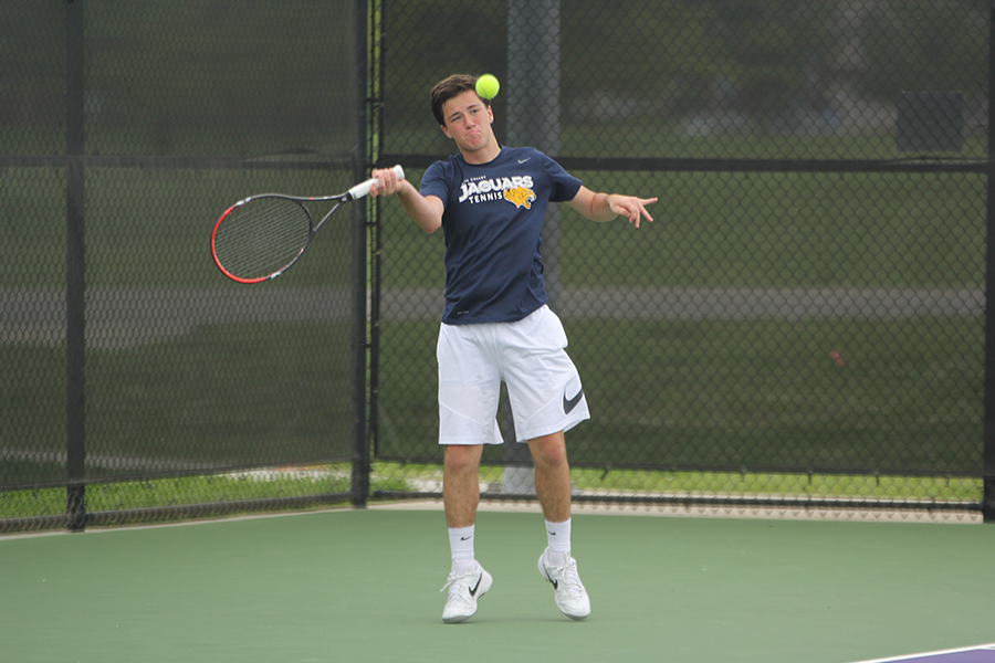 During+his+singles+match+on+Friday%2C+May+4%2C+sophomore+Joey+Gillette+prepares+to+make+contact+with+the+ball.