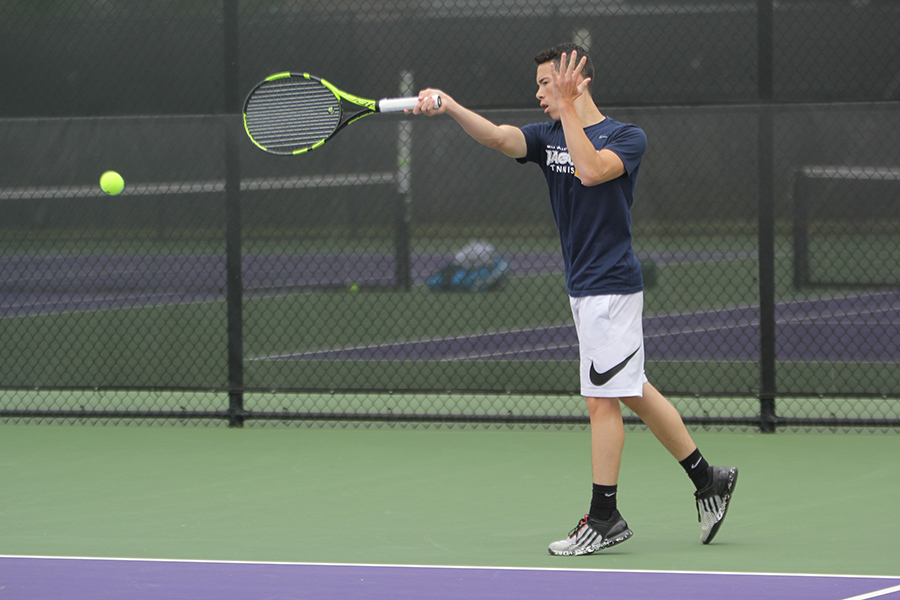 During+a+rally+during+his+match%2C+junior+Eric+Schanker+completes+a+forehand+swing.