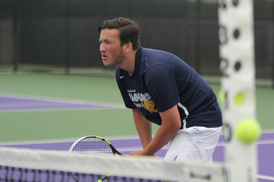 As+he+waits+for+his+doubles+partner+senior+Drake+Brizendine+to+serve+the+ball%2C+junior+Jacob+Hoffman+keeps+his+eye+on+the+De+Soto+player.+The+boys+competed+in+the+regionals+tournament+from+Thursday%2C+May+3+to+Friday%2C+May+4+at+Pittsburg+High+School.