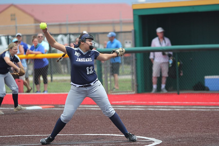 With the ball in hand, sophomore Lauren Florez gears up to pitch the ball.