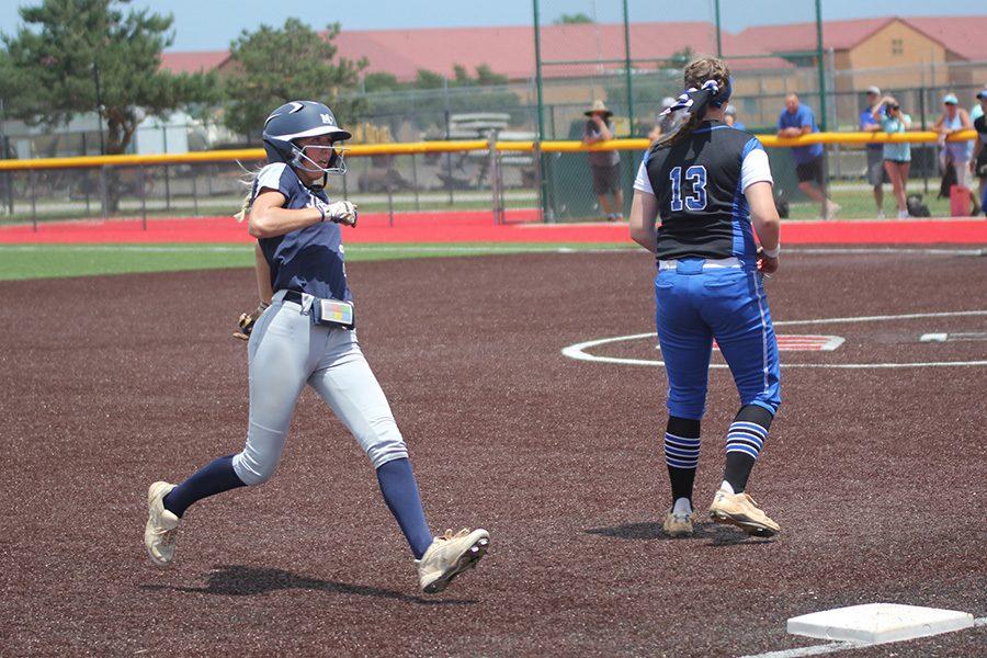 After a hit, senior Lilly Blecha runs into third base.
