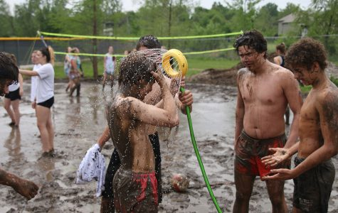 Students wash off the mud.