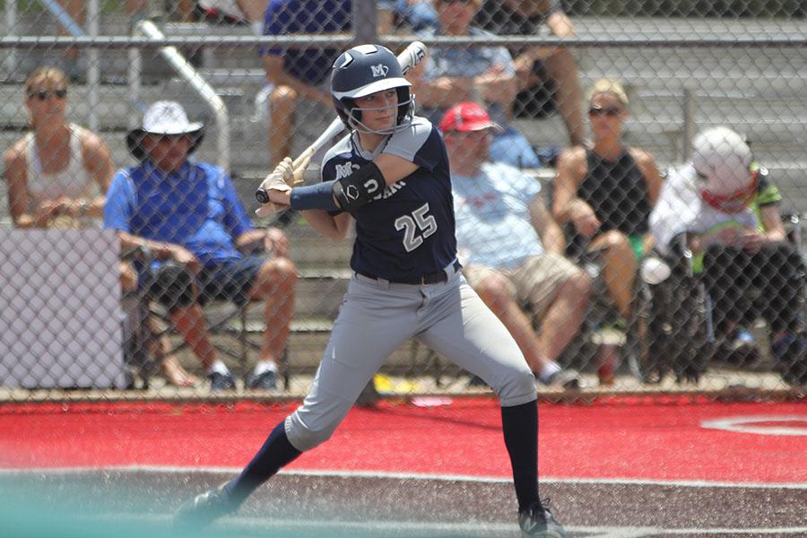 Standing+on+home+plate%2C+junior+Grace+Lovett+swings+her+bat.