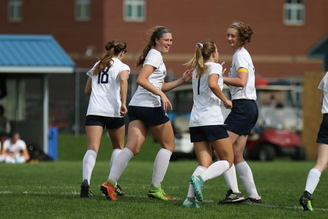After scoring a goal against the Lansing Lions on Thursday, May 3, the team celebrates.