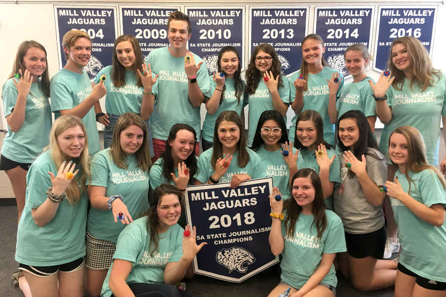 At the seminar party on Wednesday, May 9, members of the journalism state team celebrate their state championship win, along with All-Kansas awards for all three publications.