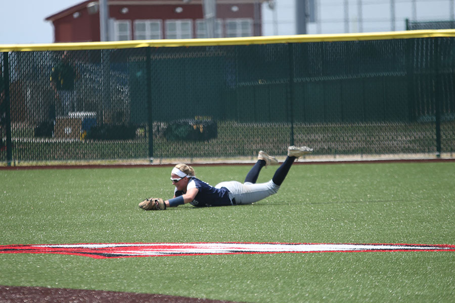 Catching+a+fly+ball%2C+senior+Peyton+Moeder+slides+on+the+field.