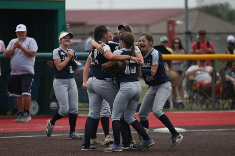 After winning the first state tournament game on Thursday, May 24, the team huddles to celebrate. The team beat Goddard High School, 7-4. The team will play again tomorrow at 11:00 AM.