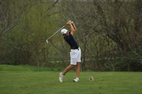 During his first year on the golf team, freshman Nick Mason Tees off.
