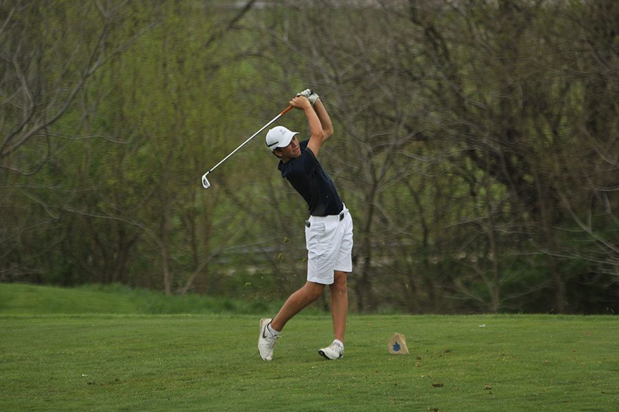 During+his+first+year+on+the+golf+team%2C+freshman+Nick+Mason+Tees+off.+