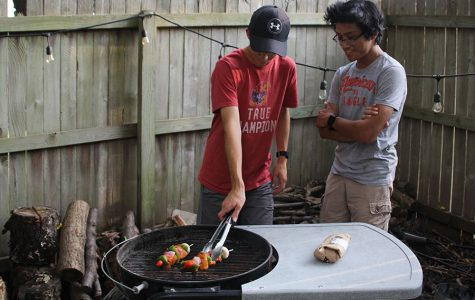 "Grilling their chicken kabobs on Sunday, Aug. 5, juniors Logan Arnold and Nico Gatapia like spending time over the summer grilling and cooking together. ""I enjoy cooking because it is a way for me to learn a new skill for later in life,"" Gatapia said.// Andrew Tow"
