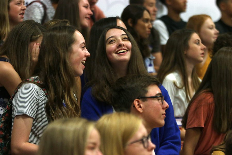 Freshman smile at the pep assembly during orientation.