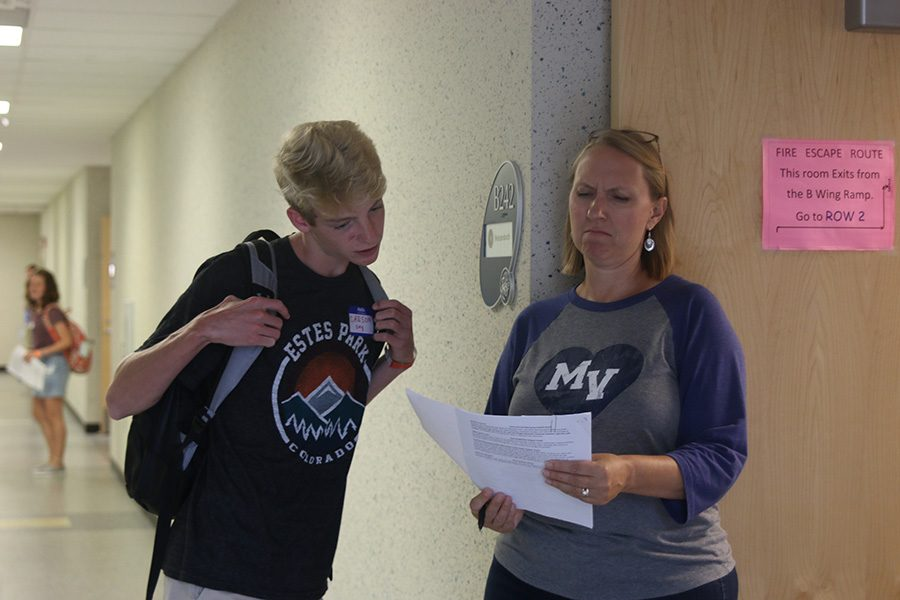 Math teacher Amy Welzenbach checks to see if a incoming freshman is in her class.