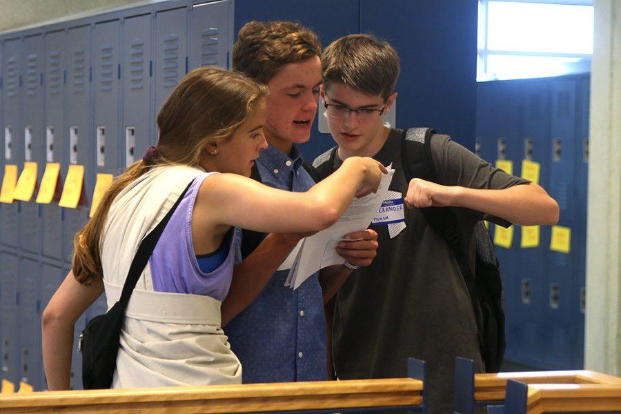 Senior Abby Layton helps a freshman find their class during orientation.