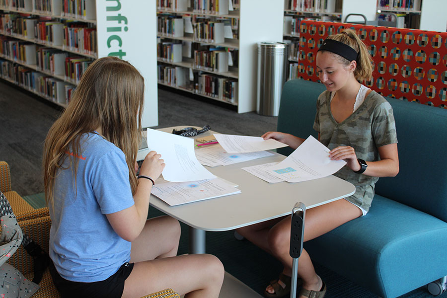 At the library on Sunday, Aug. 12, seniors Emily Proctor and Meredith Angelotti work on completing their AP Biology summer assignment.