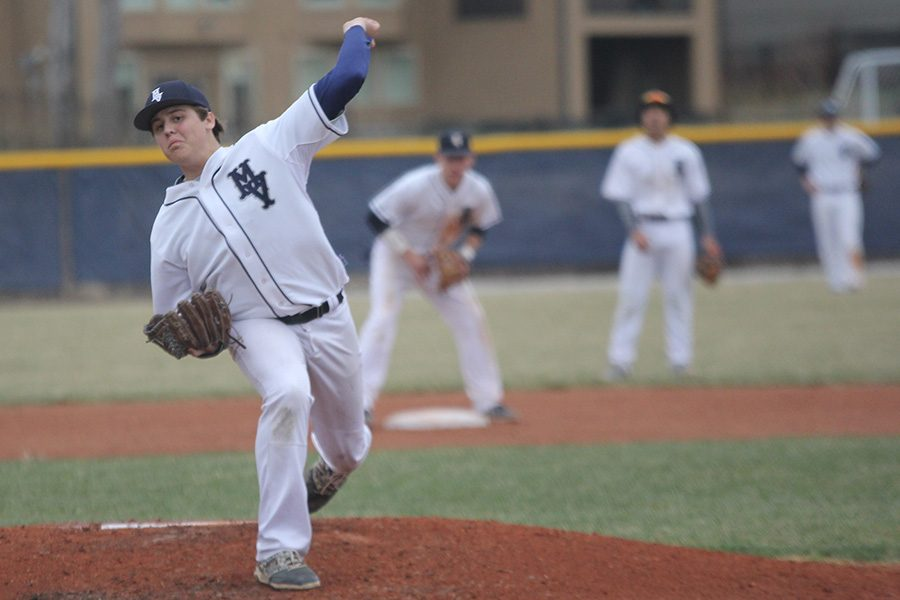 Tossing+a+pitch+during+a+game+against+SMW+in+the+2018+season%2C+senior+Nolan+Sprague+works+to+strike+a+batter+out+on+Friday%2C+March+23.+After+pitching+five+innings%2C+Sprague+led+the+team+to+a+4-1+victory.++