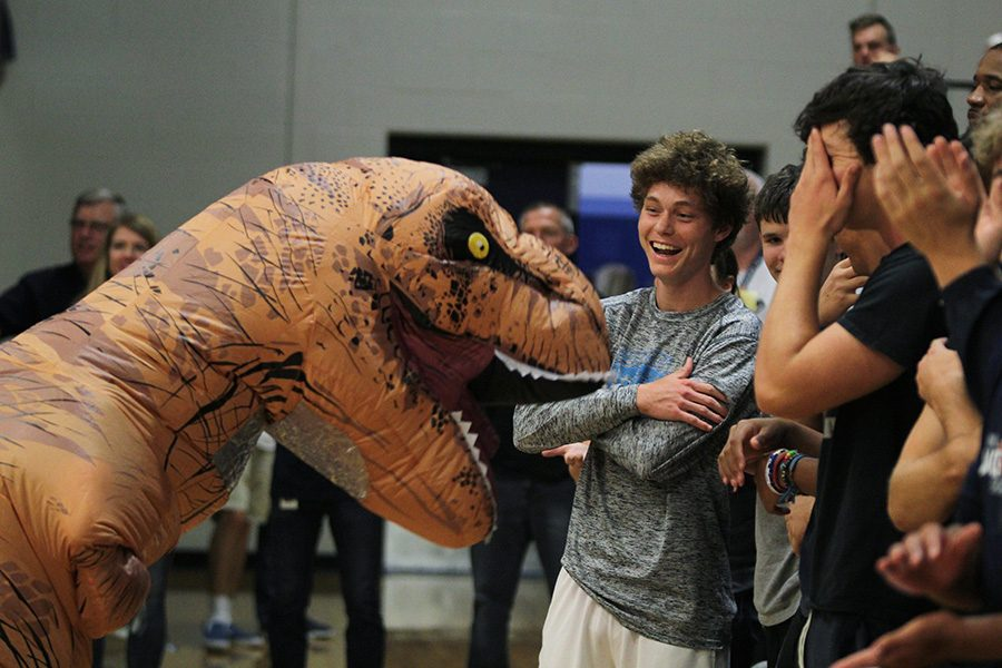 Walking+around+in+dinosaur+costumes%2C+a+StuCo+member+makes+senior+Brock+Denney+laugh+alongside+his+peers.+