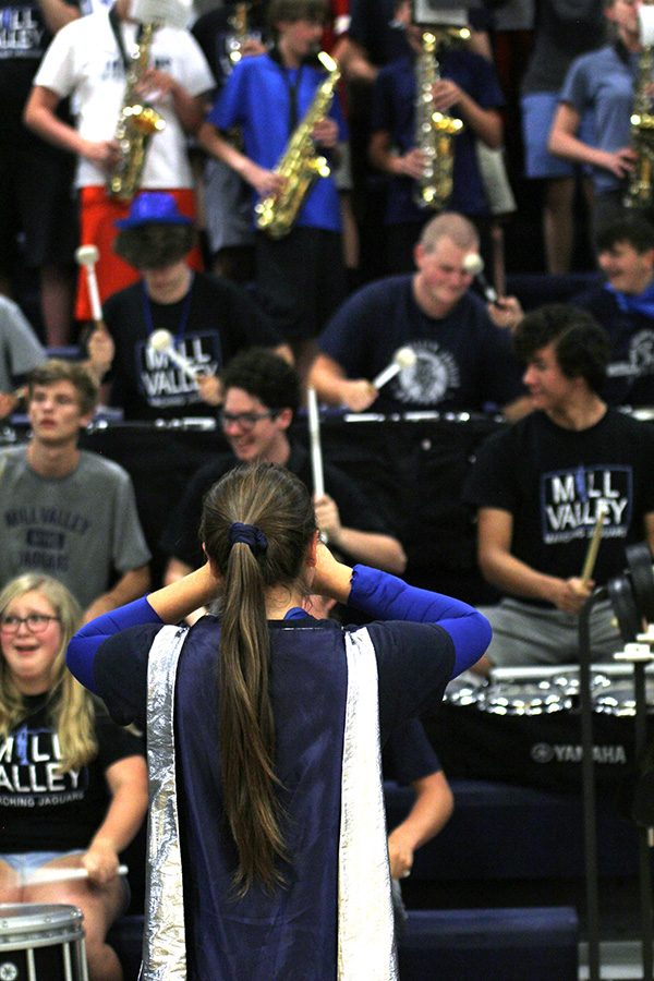 As a drum major, senior Marah Shulda helps the band stay on beat during the pep assembly.