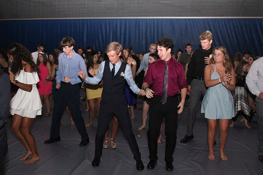As+students+line+up+in+the+main+gym%2C+sophomore+Leif+Campbell+and+junior+Cael+Duffin+dance+to+the+music.