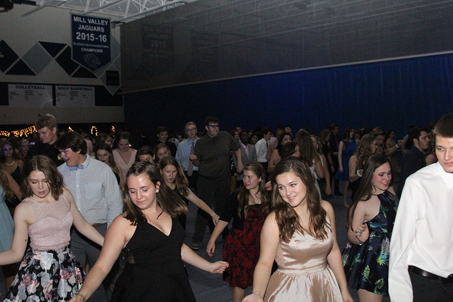 Students+get+in+rows+to+dance+to+the+music.++