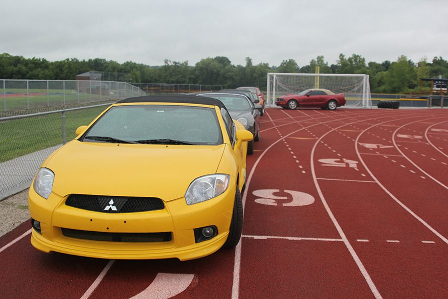At+the+beginning+on+the+line+of+cars%2C+homecoming+candidates+Kate+Backes+and+Blake+Aerni%27s+car+sits+on+the+track.