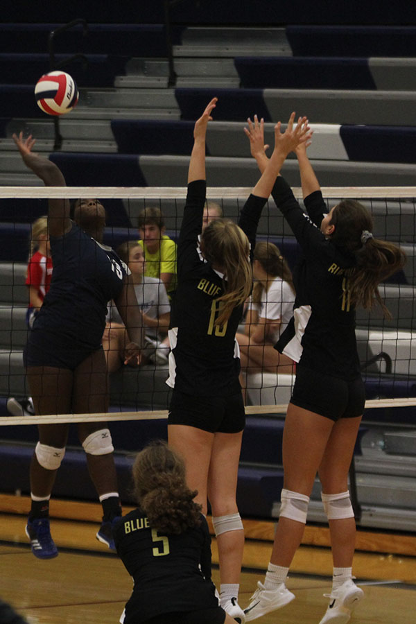 Freshman+Taylor+Roberts+spikes+the+ball+towards+her+opponents+after+being+set+the+ball+by+her+teammate.