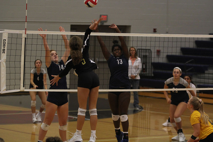 Defending+against+Blue+Valley+freshman+Brylee+Peterson+and+Taylor+Roberts+block+the+ball.