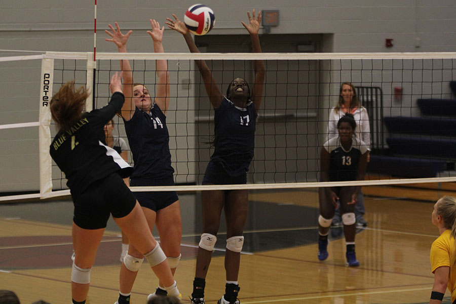 In+the+air%2C+freshmen+Brylee+Peterson+and+junior+Faith+Archibong+block+against+Blue+Valley.
