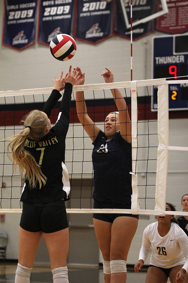 Blocking+a+tip%2C+sophomore+Carlie+Bradshaw+keeps+the+ball+in+play.+