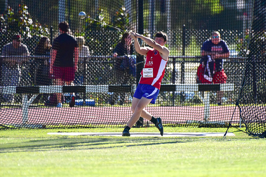 "Throwing the hammer, senior Ben Trauernicht competes at the Down Under Sports International Games in Sydney, Australia. Ben finished third in the hammer throw. ""I had a great time competing against people from other countries,"" Trauernicht said of the competition."