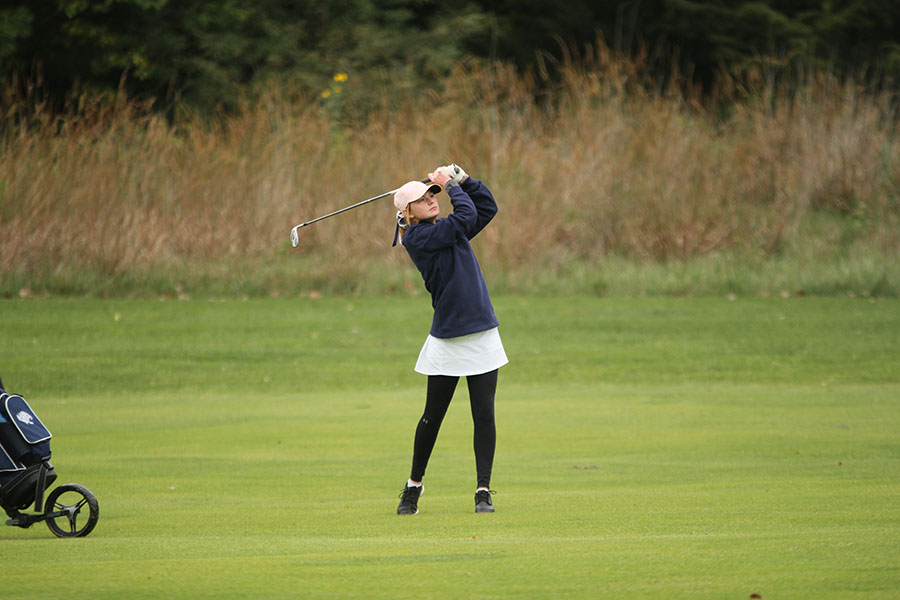 Following+through+with+her+swing%2C+sophomore+Ava+Van+Inwegen+watches+the+ball+fly+towards+the+green.