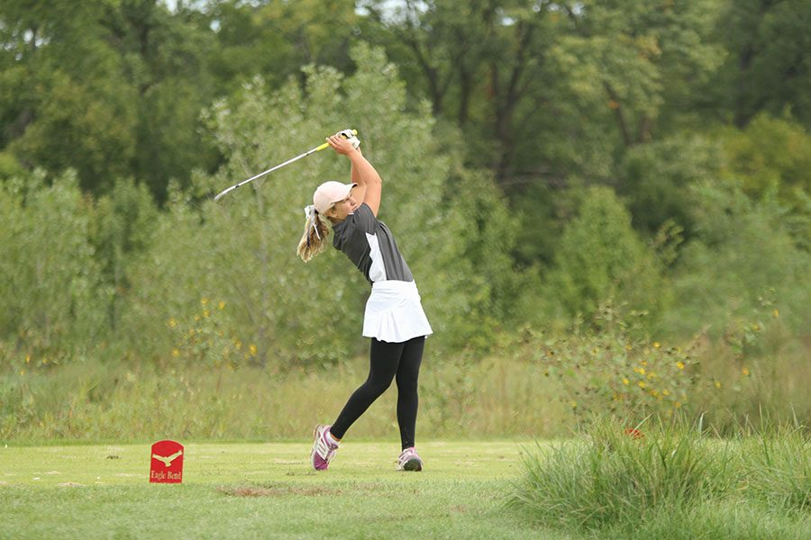 On Wednesday, Sept. 26, junior Hannah Davie hits from the twelfth tee box at Eagle Bend Country Club in Lawrence. Junior Hannah Davie placed 39th out of 132 golfers.