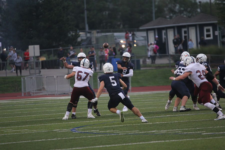 Senior+Logan+Talley+prepares+to+catch+a+pass+from+quarterback+Jordan+Preston.