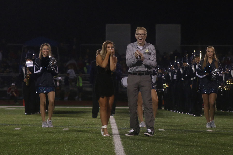 Senior Lilli Milberger bring her hands to her face in surprise after being announced homecoming queen.