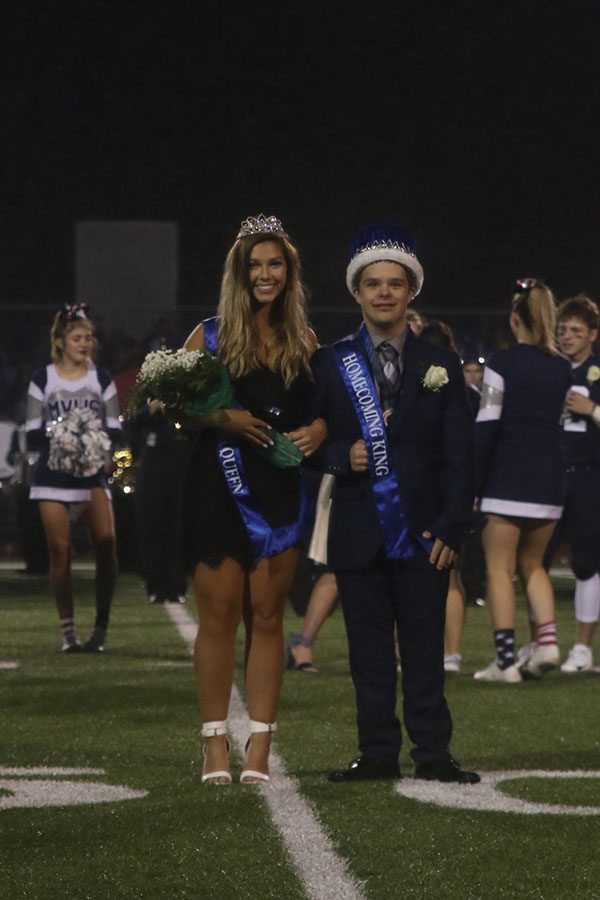 After+being+announced+as+homecoming+king+and+queen%2C+seniors+Matt+Santaularia+and+Lilli+Milberger+pose+for+photos.