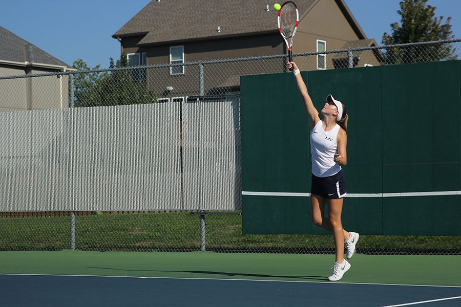 """Serving in her doubles match, junior Sydney Day puts forth a powerful hit. """"Our match was really close. We went into a tiebreaker but ended up losing in the end,"""" Day said."""