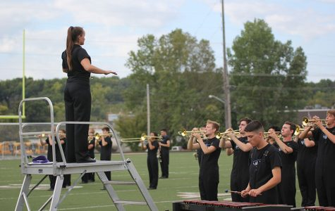 Looking out over her peers, senior Marah Shulda directs the band on Wednesday, Sept. 19th at the Bonner Springs High school competition. The Jaguar band performed their routines and received a two rating.