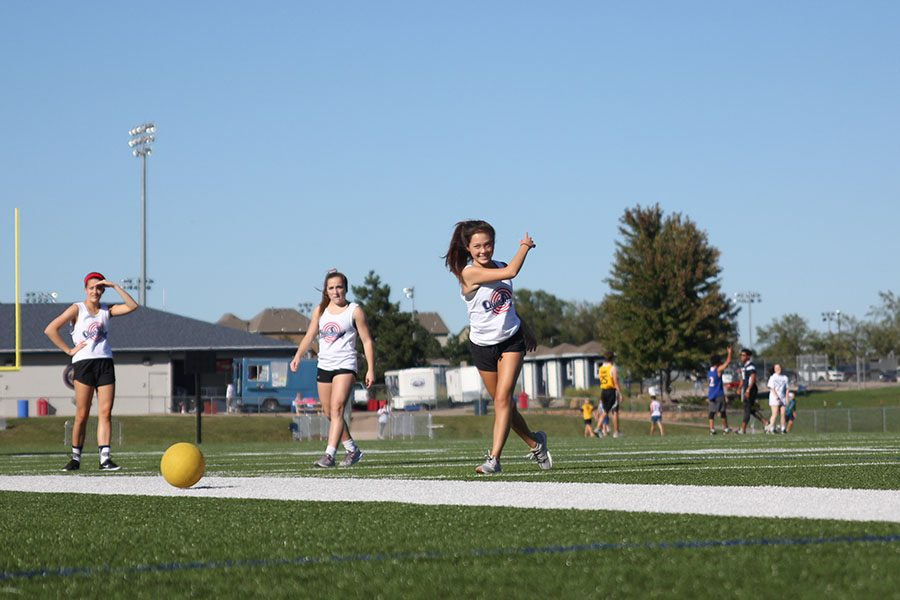 Pitching the kickball, sophomore Allison Pham plays on a team of cheerleaders.