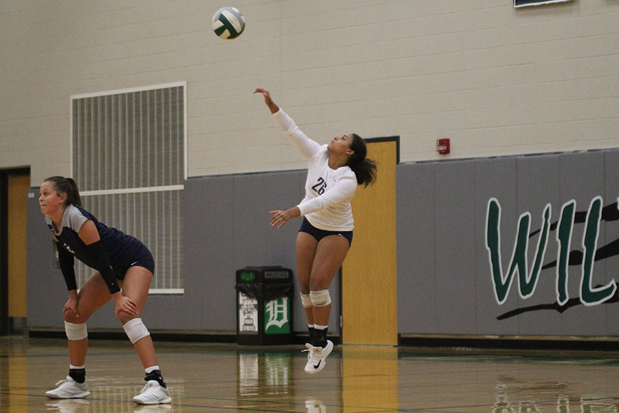 During+set+two%2C+senior+Sydney+Pullen+jumps+into+the+air+to+to+attack+the+ball.%0A