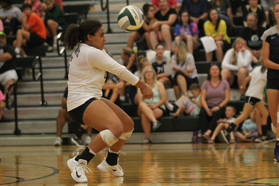 On+her+toes%2C+senior+Sydney+Pullen+watches+the+ball+hit+her+arms.%0A