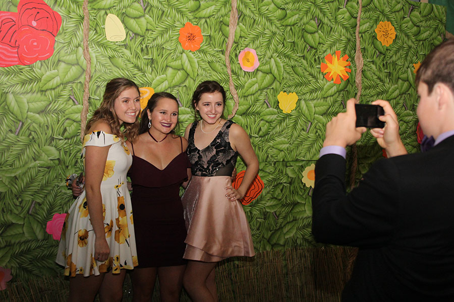 Using+the+jurassic-themed+decorations+as+a+backdrop%2C+seniors+Sophie+Friesen%2C+Marah+Shulda+and+Lauren+Rothgeb+pose+for+a+picture.